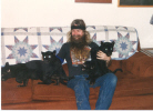 dennis with black leopard kittens.jpg (32583 bytes)